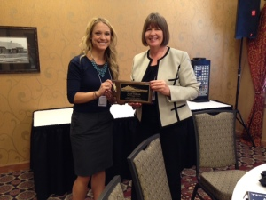 President Elect Melissa Hanson presenting Julie Parker with the 2014 School Psychologist of the Year Award at the 2014 Fall Conference